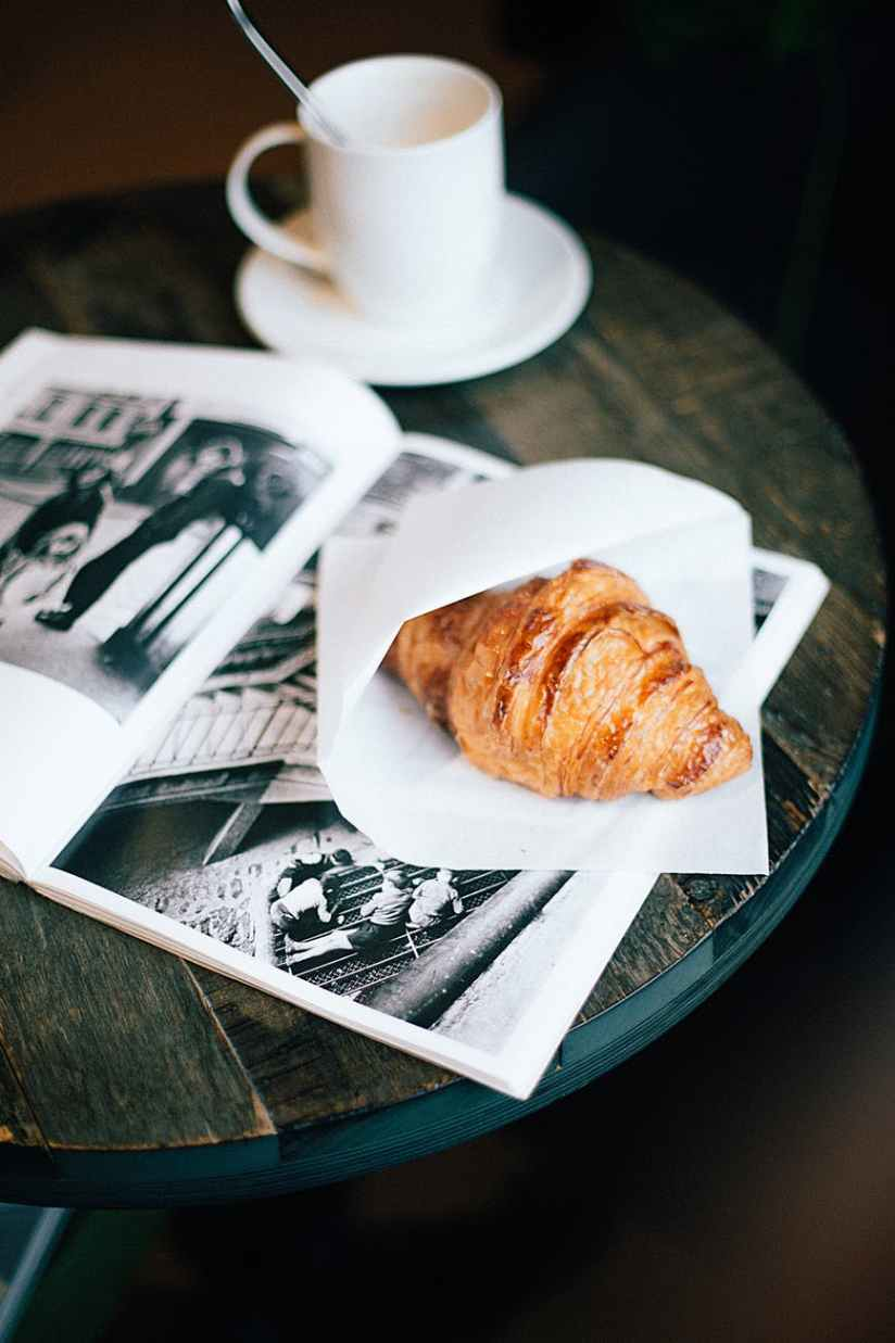 bread on wood table and ceramic cup